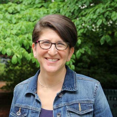 Beth Blick, director of religious school headshot with glasses.